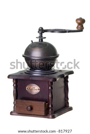 old brass coffee grinder on white background
