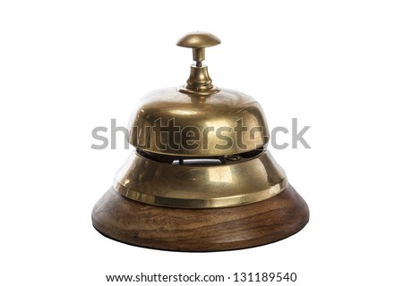 Old brass hotel bell isolated on white - stock photo