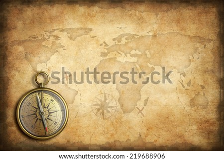 Old brass golden compass world map stock photo royalty free old brass or golden compass with world map background gumiabroncs Choice Image