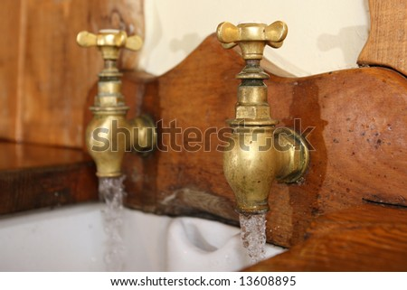 Old Brass Taps above a butler-style kitchen sink