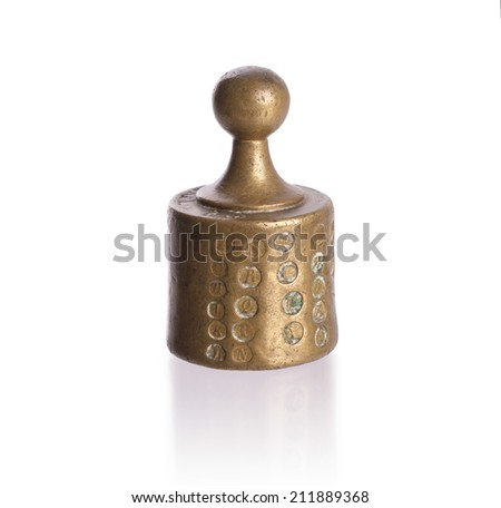 Old brass weight with shadow, isolated on white - stock photo