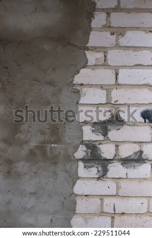 Old brick and cement wall - stock photo