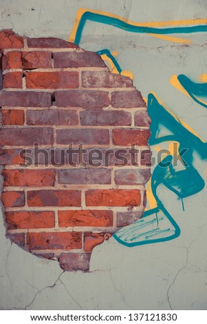 Old brick and concrete wall with graffiti