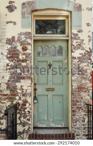 Old brick building and rustic old door in Georgetown - Washington DC - stock photo