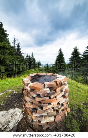 Old brick building on top of the mountains - stock photo