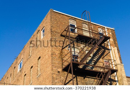 Old brick building with fire escape in small Midwest town, LaSalle, Illinois.