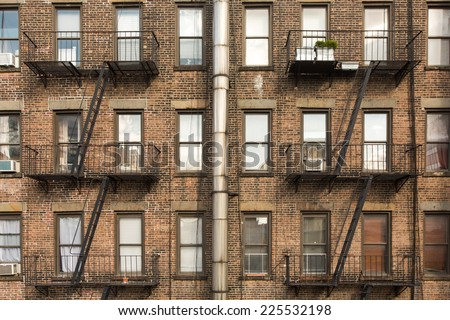 old brick building with fire escapes in front, Manhattan, New York - stock photo