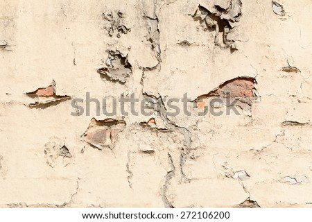 old brick cracked brick wall with broken plaster and signs of decay - stock photo