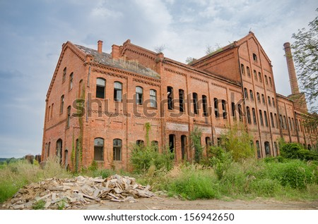 Old brick factory in Margina Town Romania with architectural and historic value being abandoned - stock photo