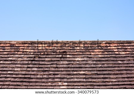 Old brick roof on blue sky background, temple roof of Asia styles