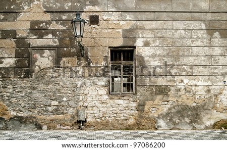 Old brick ruin wall in prague with window, and candelabras. (horizontal) - stock photo