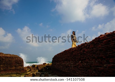Old brick wall and boulder on the beach at Tharangambadi,Tamilnadu,India.