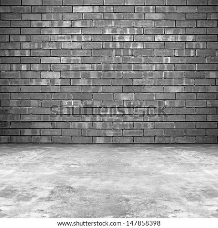 Old brick wall and concrete floor background - stock photo