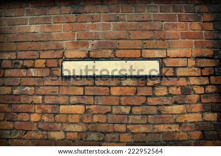 Old brick wall and vintage sign   - stock photo