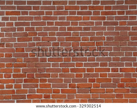 Old brick wall background, red brickwork texture, construction industry pattern