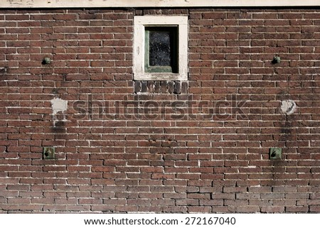 Old brick wall background with a windows. - stock photo