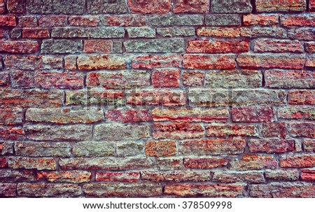 Old brick wall. Colorful brick wall. Background brick wall.  Stone wall. Apply color and lighting effects for textured background.  Vignetting background. - stock photo