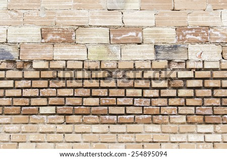 Old brick wall, detail of an old wall in ruins - stock photo