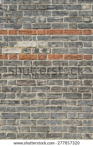 Old brick wall details and texture closeup vertical view - stock photo