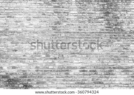 old brick wall. fortress interior block vignette facade wallpaper rustic brickwork dark white basement layout architectural design vintage detail surface spot beams stained grey closeup spot cracked - stock photo