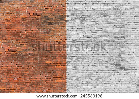 Old brick wall half-painted in white - stock photo
