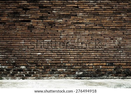 Old brick wall in a background image - stock photo