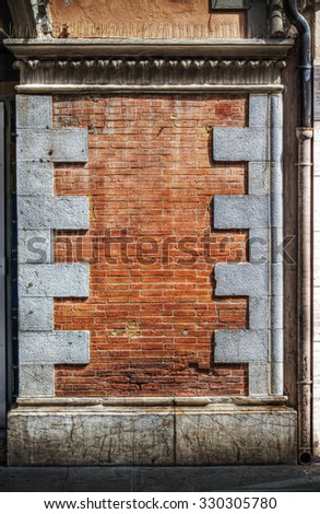 old brick wall in hdr tone mapping effect - stock photo