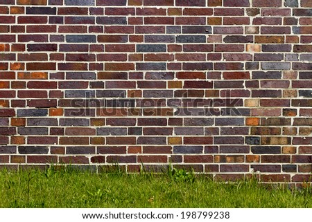 old brick wall of bricks of different colors