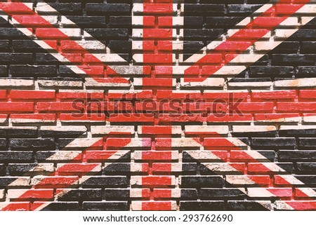 Old brick wall paint color copy British flag for texture background and black drop.Used film filter for vintage  tone. - stock photo