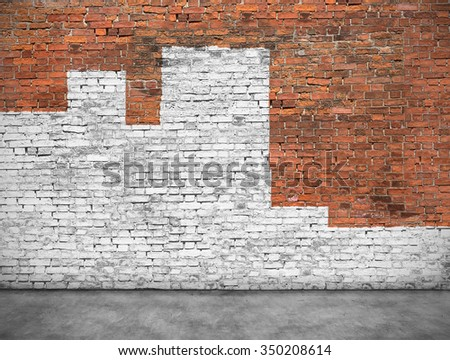 Old brick wall painted with white paint - stock photo