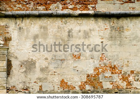 Old brick wall texture background, colorful and cracked