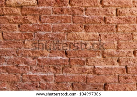 Old brick wall texture background in Venice, Italy.