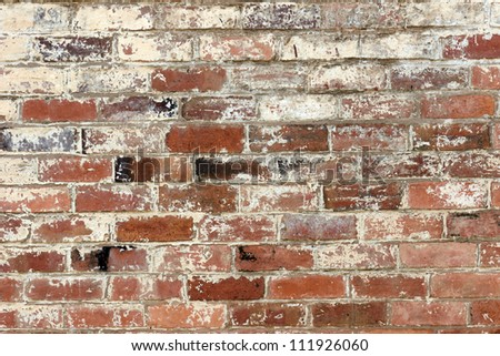 old brick wall texture background with worn off paint - stock photo