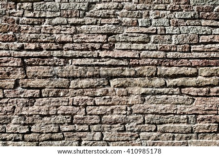 Old brick wall. Vintage brick wall. Background brick wall. Stone wall. Apply color and lighting effects for textured background. Vignetting background. - stock photo