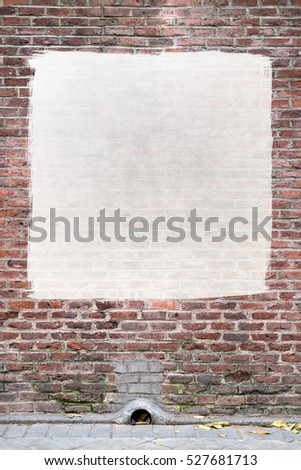 Old brick wall with a painted white square ideal for customization