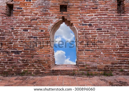 Old brick wall with blue sky. - stock photo