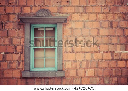 Old Brick Wall with Blue Window, vintage color.