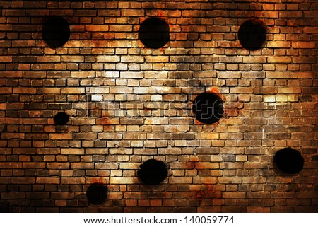 Old brick wall with bullet holes - stock photo