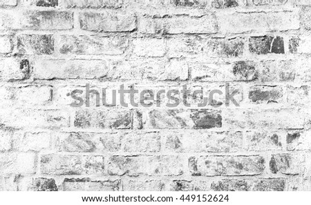 Old brick wall with damaged white paint layer, closeup background photo texture. Seamless composition - stock photo