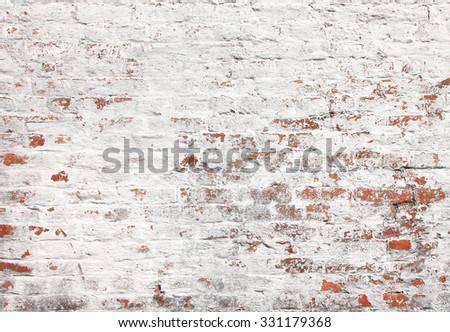 Old brick wall with white stucco - stock photo