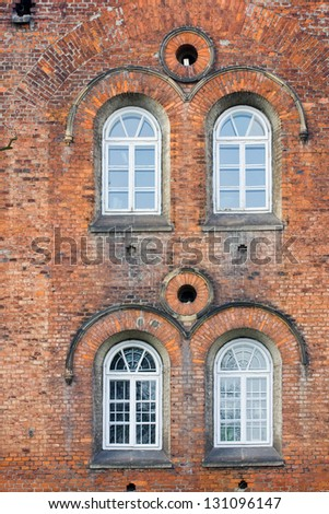 Old Brick Wall with White Windows