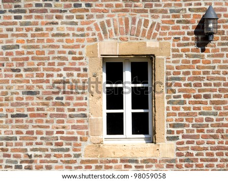 Old Brick Wall with window - stock photo