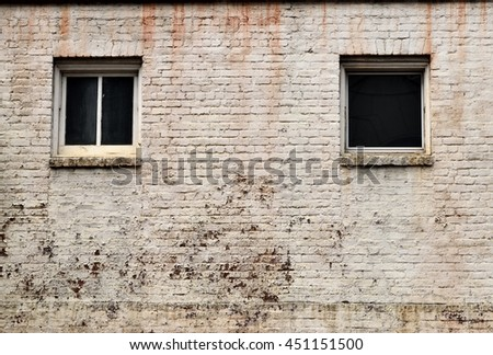 Old brick wall with windows background - stock photo