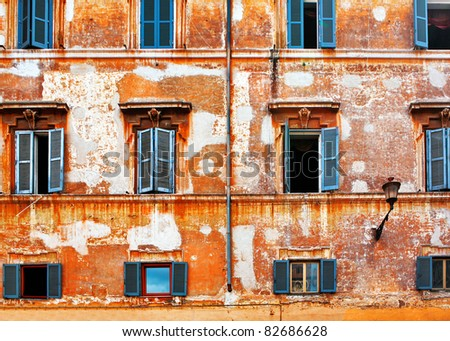 Old brick wall with windows in Venice. Italy