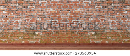 Old brick wall with wooden floor room - stock photo