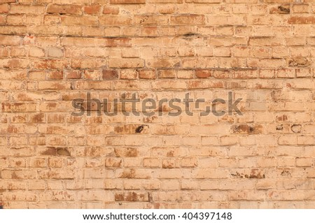 old brick wall, yellow background - stock photo