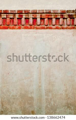 Old bricks on a white wall - stock photo