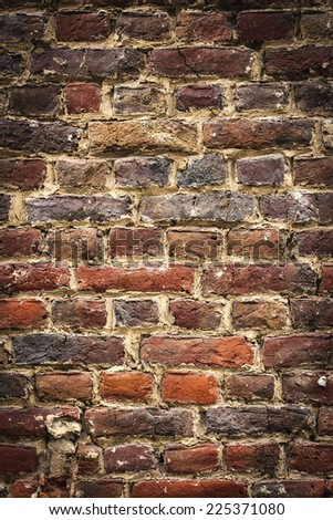 old brickswall, vertical background with black vignette borders
