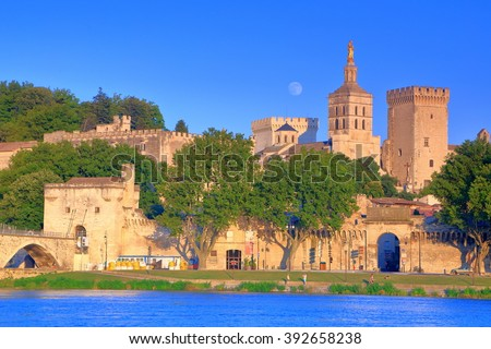 Old bridge and the Cathedral and Papal Palace (Palais des Papes) near the Rhone river, Avignon, Provence, France - stock photo