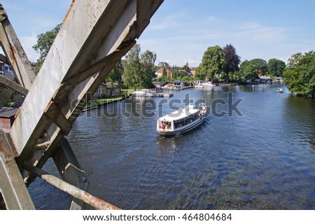 Old bridge crossing a canal with an old ship sailing between two of Silkeborg lakes in the center of Jutland
